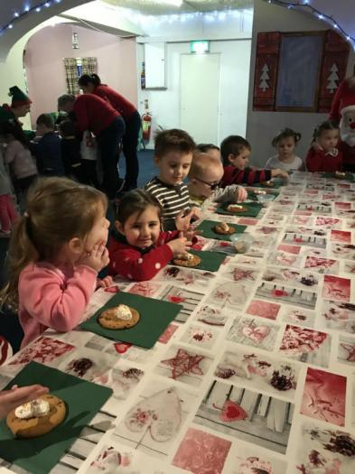 decorating cookies in Mrs Claus' kitchen