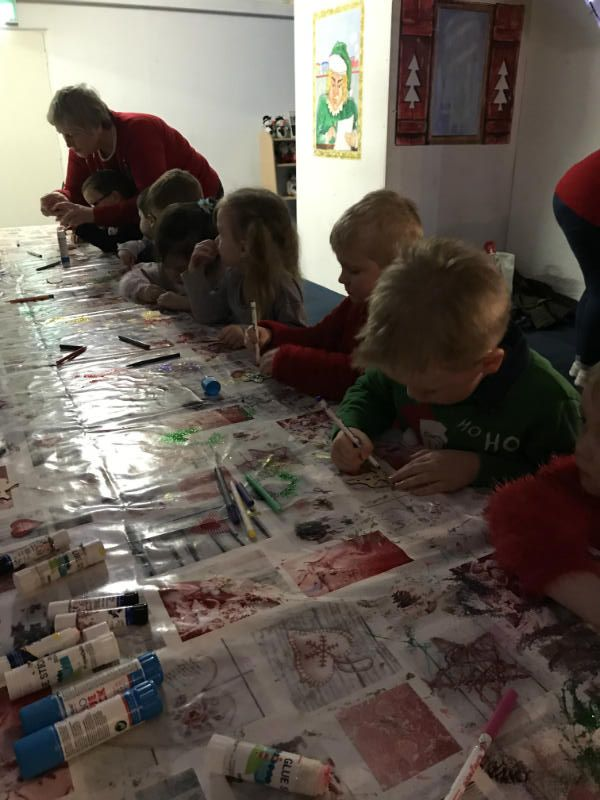 making Christmas tree decorations in Mrs Claus' kitchen